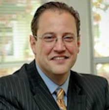 Picture of attorney MacDaniel E. Reynolds